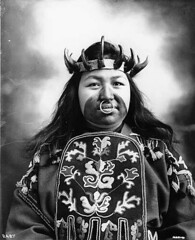 Tlingit woman named Kaw-Claa wearing her potlatch dancing costume, Alaska (UW Digital Collections) Tags: embroidery hats facepaint tlingit headdress crowns nosepiercing noserings bullrings embroideredshirt septumpiercings tlingittribe frankhnowell kawclaa potlatchdancingcostume ceremonialfacepaint tlingitwoman potlatchcostume