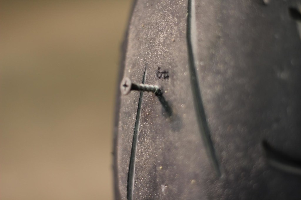 Drywall Screw in Dunlop Q2 rear tire