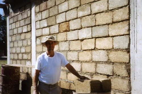 Image of Jeff Behringer on the job, constructing a building with cinderblocks, which he often uses in stone masonry projects
