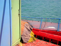 Fisherman's Chronicles, part 52 (SilViolence) Tags: wood red sea summer colour verde net colors port greek see fisherman nikon barca mare colours colore estate marin bat cyan hellas greece porto grecia coolpix rosso azzurro colori anta marino zante zakynthos pescatore legno barchetta rete ante sacco ionian maniglia p50 alykes zacinto nikoncoolpixp50 coolpixp50 colorfullaward αλυκέσ
