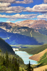 Glacial Valley (Jim Boud) Tags: travel blue mountain lake canada mountains green nature water pinetree clouds canon lens landscape outdoors eos hotel is nationalpark colorful paradise peace shadows hiking hill smooth relaxing rocky peaceful canadian lodge shore alberta valley northamerica banff usm dslr lakelouise chateau 1785mm digitalrebel relaxed photoart digitalslr pinetrees efs1785mmf456isusm province firtree waterscape artisticphotography partlycloudy canadianrockies glacialvalley photomatix imagestabilization imagestabilized 550d jimboud t2i exposurefusion jamesboud eos550d kissx4