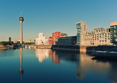 Medienhafen Reflection II (Philipp Klinger Photography) Tags: city travel sunset summer sky urban reflection tower water architecture reflections river frank nikon warm gehry nrw dsseldorf rhine rhein philipp frankgehry duesseldorf medienhafen klinger d700 dcdead