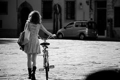 (| Mick the mic |) Tags: street portrait people blackandwhite bw woman monochrome bike canon florence dof noiretblanc candid streetphotography sigma biancoenero ih 50d 18125mm urbanlifeinmetropolis flickraward bwartaward scattidistrada ritrattidalmondo blackdiamondpremier fotografinewitaliangeneration