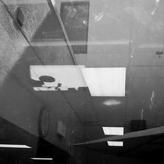shades of alexander calder (johngpt) Tags: reflections blackwhite hospitalcafeteria outsidelookingin notextureadded vignetteforandroid justadirtywindow motoroladroidx portraeffect wheresalexandercalderwhenwereallyneedhim