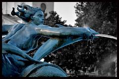 Fountain detail (osbo) Tags: england london water fountain statue slick shiny aqua dolphin trafalgarsquare spray mermaid slippery