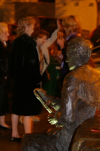 People meet at the statue of Séamus Ennis outside The Centre.