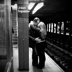 Union Square Station Lovers (antonkawasaki) Tags: nyc newyorkcity blackandwhite bw portraits candid streetphotography squareformat tendermoment 500x500 iphone4 subwaylife iphoneography antonkawasaki unionsquarestationlovers manleaningagainststeelbeam blondewomanleaningagainsthimwitharmswrappedaround kissinghisnose monochromiaandformat126apps