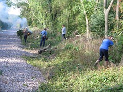 Volunteers busy trimming the summer regrowth from the sides of the trackbed