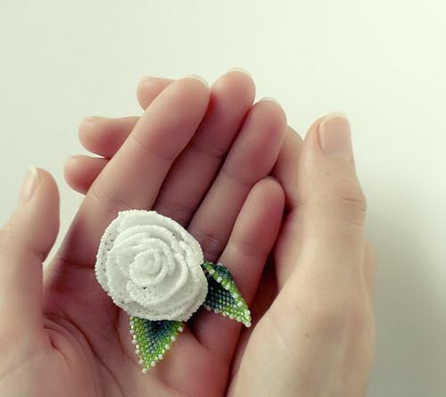 brooch in hands