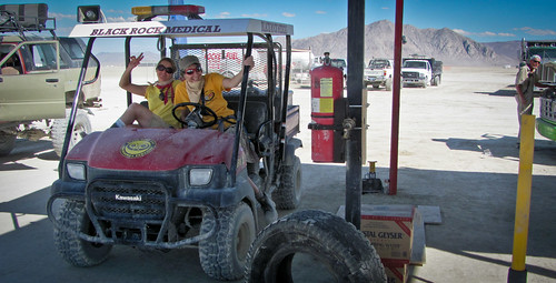 A medical team takes a break from prowling the playa to blow out their air filter