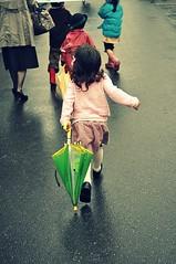 Wait for me! (Stevetsunami) Tags: pink school girl rain umbrella little walk running run skirt rush firstday wait late