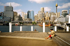 (sphmao) Tags: city sky woman building film water girl 35mm photography reading book harbour sydney olympus xa