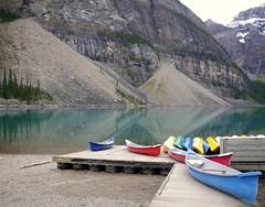 Canoes at Moraine Lake (katrin glaesmann) Tags: lake holiday snow canada mirror boat canoe 2010 banffnationalpark canadianrockies rockflour