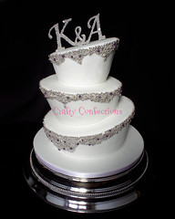 Bedazzled! (Crafty Confections) Tags: ireland wedding 3 cakes cake silver monogram cork bling wonky madhatter topper tier midleton topsyturvy dragees cashous craftyconfections