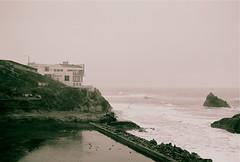 Cliff House Fogged In... (DowntownRickyBrown) Tags: ocean morning bw cliff white house black beach 50mm nikon san francisco kodak foggy saturday 200iso e baths sutro nikkor 18 fm10 400cn earrrrrrly