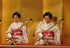 Geisha playing a shamisen, Mamehana & Mamesome:舞妓、豆はな と 豆そめ (Nullumayulife) Tags: red woman white cute art colors girl beautiful beauty japan female asian japanese kyoto traditional young exotic maiko geisha kawaii 京都 belle 日本 祇園 nippon kimono obi gion shamisen japon giappone nihon 2010 着物 美女 japao japonês 女 伝統 白 赤 芸者 日本人 japanisch 美人 女性 japonaise 踊り 芸妓 舞妓 藝妓 三味線 japanishe mamehana 豆はな mamesome 豆そめ 娘道成寺