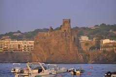 Aci Castello Sicily Italy - Creative Commons by gnuckx (gnuckx) Tags: travel sunset sea summer vacation sky italy sun beach rock skyline port landscape islan