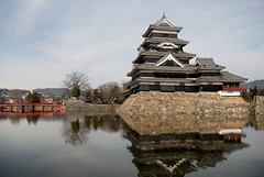 The Keep (Mark Liddell) Tags: city bridge red reflection castle japan wall japanese ancient treasure ken jo historic special national keep  nippon walls crow moat matsumoto prefecture shi nagano tohoku nihon kaku jou  gatehouse  karasu  matsumotojo tenshu  matsumotojou karasujo hirajiro karasujou