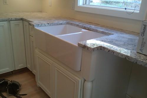 backsplash with white cabinets white granite countertops