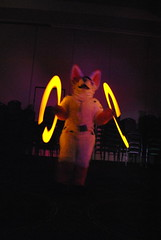 Clementine twirls glowsticks
