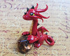 Red Dice Dragon (DragonsAndBeasties) Tags: red sculpture dice black cute statue gold miniature wings dragon burgundy maroon ooak magic small mini sparkle polymerclay fimo fairy fantasy gift handpainted sculpey etsy custom figurine commission shimmer premo 20sided