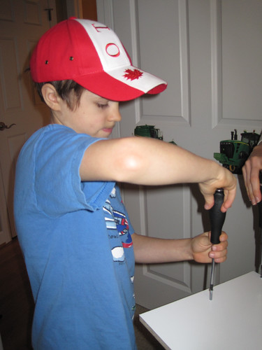 JD Boy (age 7) screwing the case together