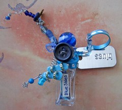 Miniature Assemblage Glass Bottle Blue Skies with Dangling and Flying Embellishments Galore (Enchanticals ~I'm Coming Back) Tags: blue sky flower glass up metal silver neck paper stars miniature beads leaf spring bottle aluminum shiny colorful skies handmade assemblage circles navy feather balls happiness down plastic rings fantasy thongs delight round button flipflops bead blueskies marble etsy coil joyful heavens disc eternity magical dangle charms enchantment curiosities enchanted sideways whimsical celestial delightful stopper alteredart movable findings outstretched flexible dogtag vintagebutton bottleart outwards alteredbottle elasticized enchanticals enchanticalsetsy cycleswire