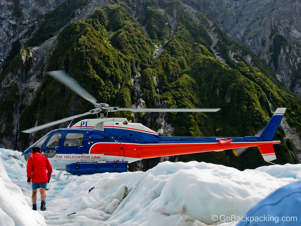 Helicopter landing on Franz Joseph Glacier, New Zealand.