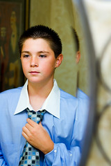 Growing Up (justinswindle | photography) Tags: blue boy white reflection up fun bathroom 50mm mirror play dress innocent assignment young handsome tie knot institute suit corey restroom growing collar growingup brooks childish