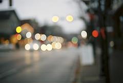 city alight (jamie {74}) Tags: street 35mm nikon bokeh dusk streetlamps f100 headlights nikkor naperville oof kodakportra160nc hbw sooc bokehlights bokehwednesday blartsy nikkor50mmf14g