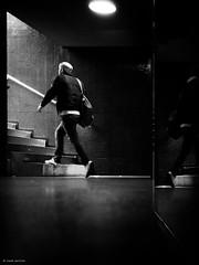 Follow the white rabbit (René Mollet) Tags: dark down under underground reflection man blackandwhite bipolar rabbit hurry urban street silhouette shadow streetart