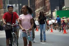 A kid riding a scooter on Lafayette Street during Summer Streets. (jackszwergoldarchives) Tags: manhattan newyorkcity summerstreets szwergold