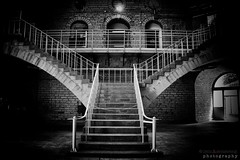 which path will you choose? (lynn.h.armstrong) Tags: kingston ontario canada black white bw wb monochrome july 2017 penitentiary shop dome stairs prisoners prison brick windows doors railing rail arch