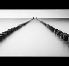 Converging Lines (fotoscape2009) Tags: longexposure blue sea bw reflection water netherlands rock europe ralf simple continent groyne 5dmkii