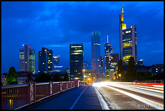 Frankfurt - Mainhattan Skyline and Evening Twilight Traffic (Yen Baet) Tags: longexposure reflection church skyline night river germany deutschland twilight europe cathedral dusk frankfurt bluehour commerzbank rhineriver mainriver maintower rhinelandpalatinate frankfurtcathedral traveldestination eisenersteg