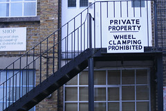 Wheel Clamping on balcony (TraceySiu) Tags: building wheel sign stairs balcony clamping