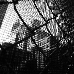 Urban Fences (Airicsson) Tags: street new york city nyc summer urban blackandwhite bw usa white ny black island lumix us walk manhattan fences panasonic 2010 streetshot blackwhitephotos lx3