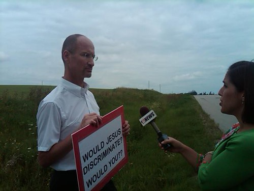 Bob Werner, a pro-equality supporter, being interviewed in Rochester, MN