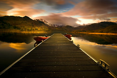 Lakes (dan barron photography - landscape work) Tags: sunset snow mountains water clouds speedboat lakedistrict calm tranquil