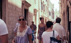street-walkers (Tanya Skvortsova) Tags: travel summer colour film xpro crossprocessed croatia slide nikonf100 reverse dubrovnik fujivelvia100 epsonv700 july2010 nikkor50mmf14g