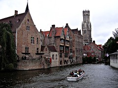 Canal cruise by Bruges. (davidezartz) Tags: old travel cruise pink blue trees windows light red sky people brown white black green water yellow architecture clouds buildings reflections portland grey boat town canal nikon europe doors shadows belgium belgique watches brugge roofs belfry american poet bruges marketplace soe longfellow belfort thrice canalcruise consumed educator belfrey e3100 blueribbonwinner henrywadsworthlongfellow supershot thegalaxy nikone3100 nikonstunninggallery abigfave theloveshack rebuilded flickraward citrit theunforgettablepictures platinumheartaward betterthangood goldstaraward anticando dragondaggeraward platinumbestshot platinumpeaceaward 18071882 mygearandme mygearandmepremium mygearandmebronze mygearandmesilver canalcruisebybruges thebelfreyofbruges