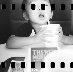 i'm lovin' it (kAz_55) Tags: bw japan 35mm child neopan1600 holga120cfn
