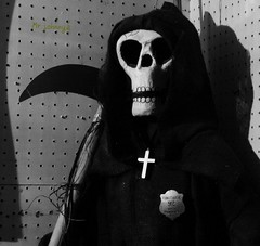 constable 92 (old mr_johnnya) Tags: bw white black skull gold shadows grim reaper badge 92 constable scythe pegboard goldcross papermaiche