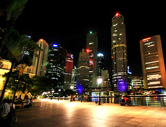 Big City Lights in Singapore (` Toshio ') Tags: city trees people water architecture night buildings reflections lights restaurant harbor cafe singapore asia downtown neon cityscape nightshot quay palmtree cbd boatquay centralbusinessdistrict toshio