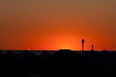 Dawn over tent city (nosha) Tags: ocean new sea vacation sky orange sun holiday lamp beautiful beauty clouds sunrise dawn newjersey streetlight grove horizon nj tent jersey rise 2010 lightroom oceangrove tagsale nosha