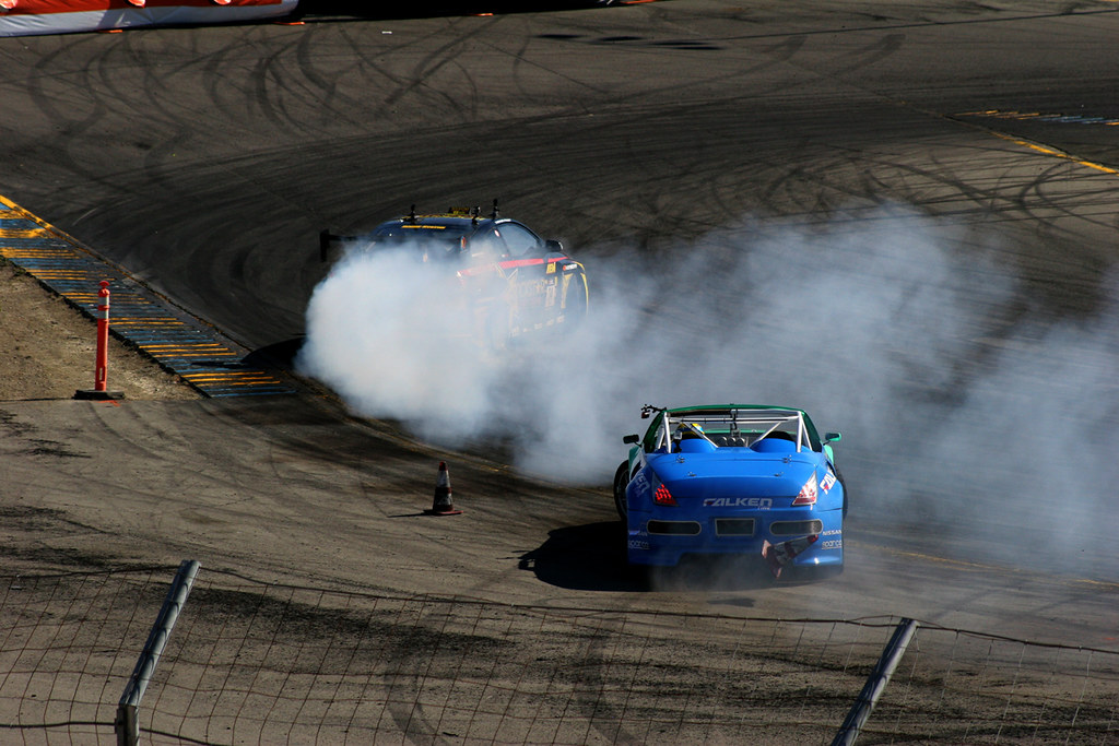 Rockstar's V8 RWD Scion TC Driven By Tanner Foust Going into the First  Point Like A Beast As Falken Tire's V8 350Z Driven By Tyler McQuarrie Manages to Find the Dirt at Formula Drift Round 6 2010 at