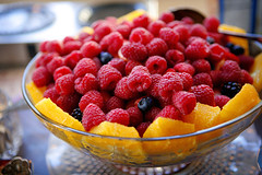 our breakfast fruit bowl piled high with oranges and rasperries and stawberries