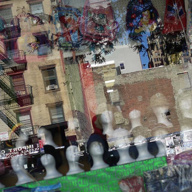 bulk hats & people heads inside the window #walkingtoworktoday