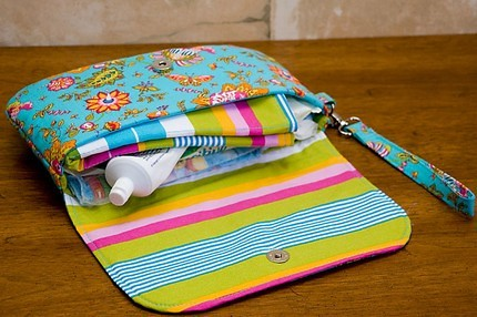 Grab 'n' Go Diaper Clutch holds it all