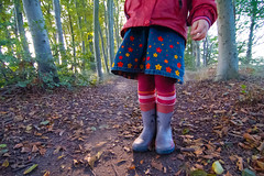girl in the forest (POSITiv) Tags: flowers autumn trees light red green forest hand legs tights skirt jacket rgen striped rubberboots positiv glrfamily2011